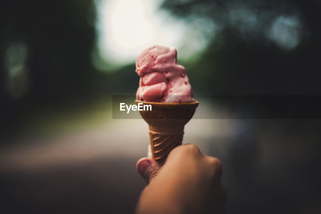 Close-Up Of Person Holding Ice Cream Outdoors