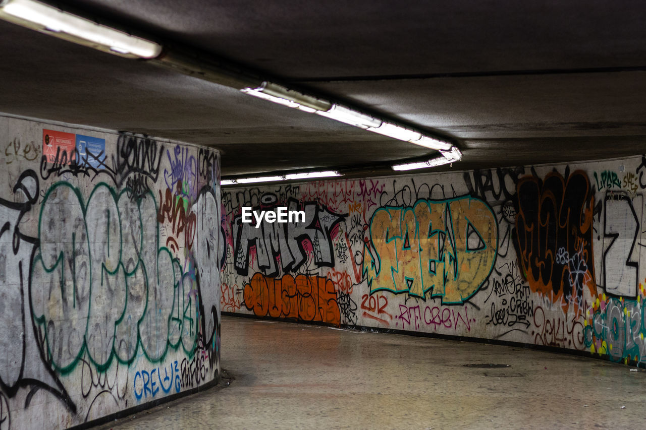 graffiti, creativity, art and craft, street art, built structure, tunnel, architecture, multi colored, indoors, no people, day