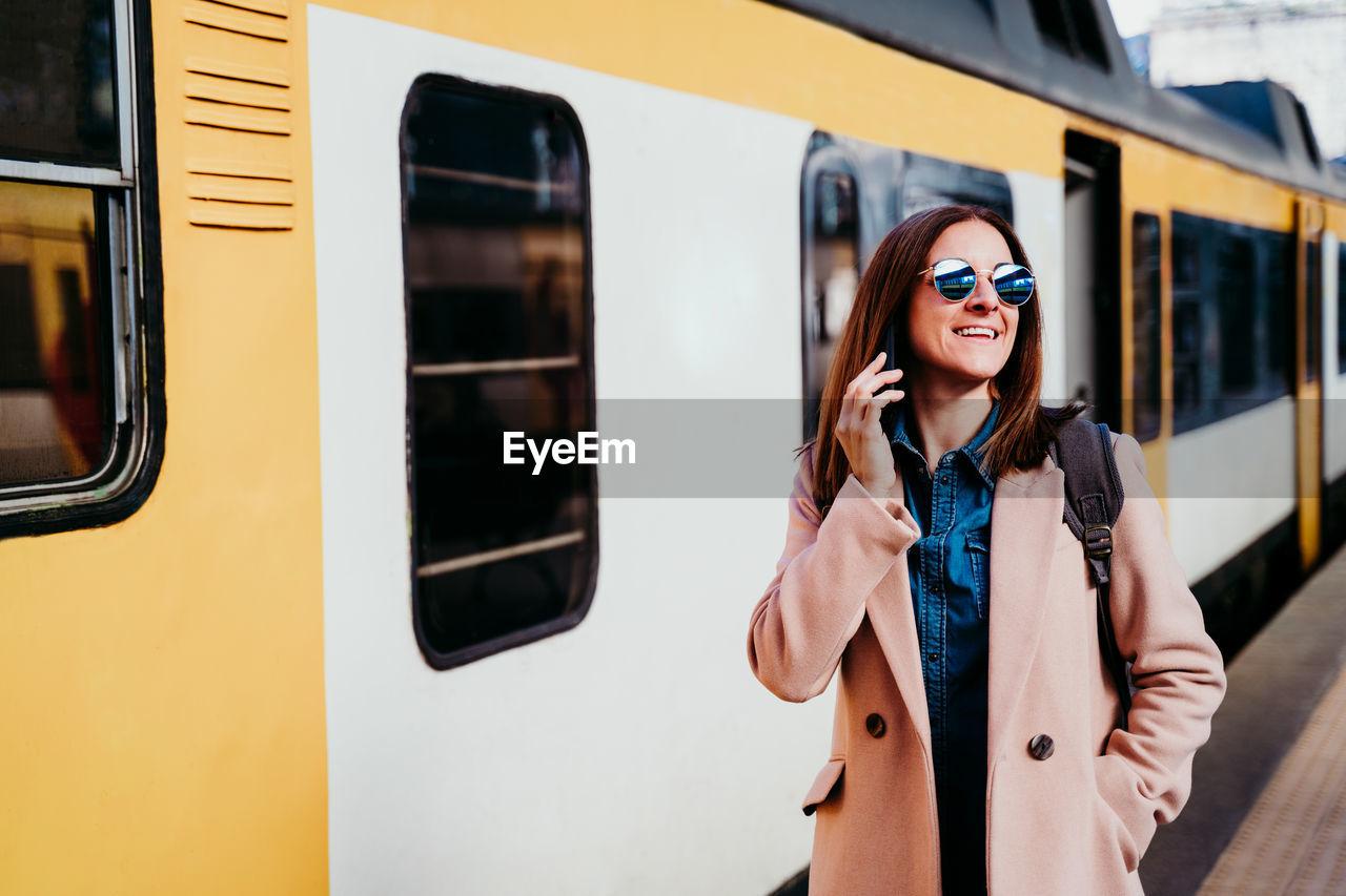 BEAUTIFUL WOMAN STANDING BY TRAIN