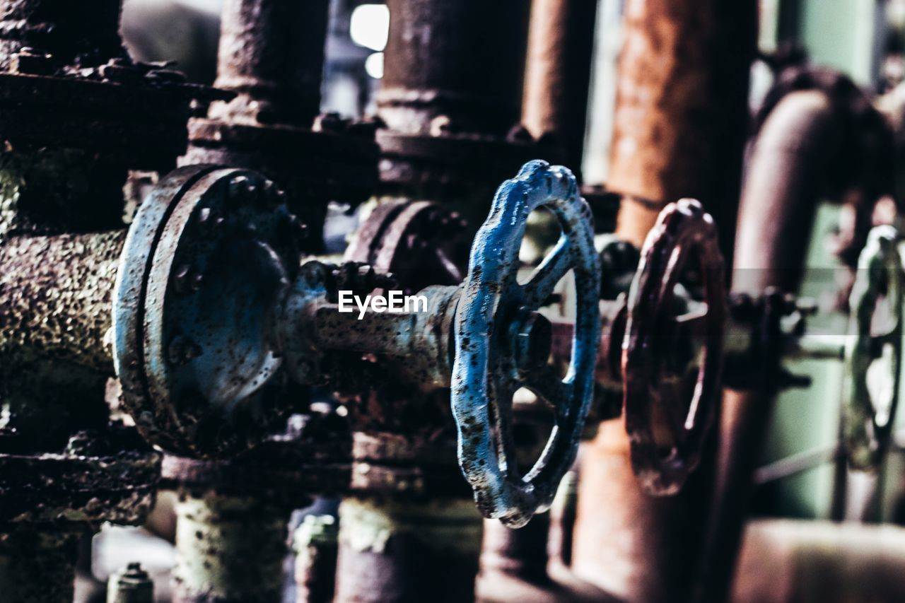 Close-up of valve in rusty pipes
