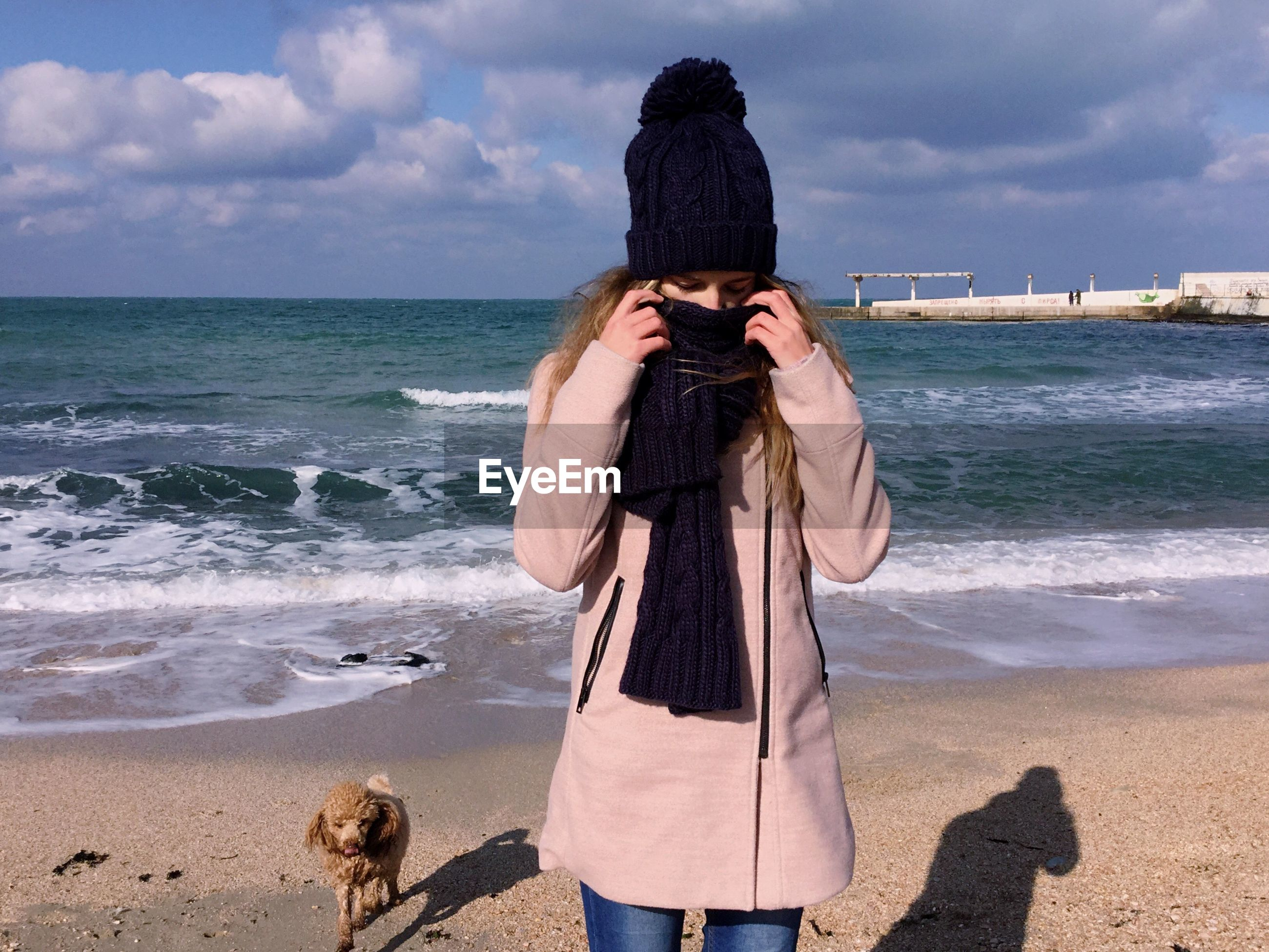 sea, beach, horizon over water, standing, only women, one person, one woman only, adults only, rear view, adult, outdoors, people, sky, day, women, wave, warm clothing, water, human body part