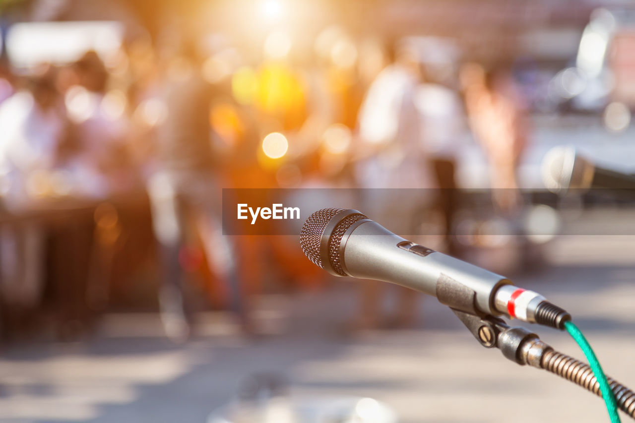 focus on foreground, music, close-up, input device, audio equipment, microphone, arts culture and entertainment, technology, cable, metal, no people, indoors, musical instrument, selective focus, electric plug, business, communication, musical equipment, connection, stage, electrical equipment