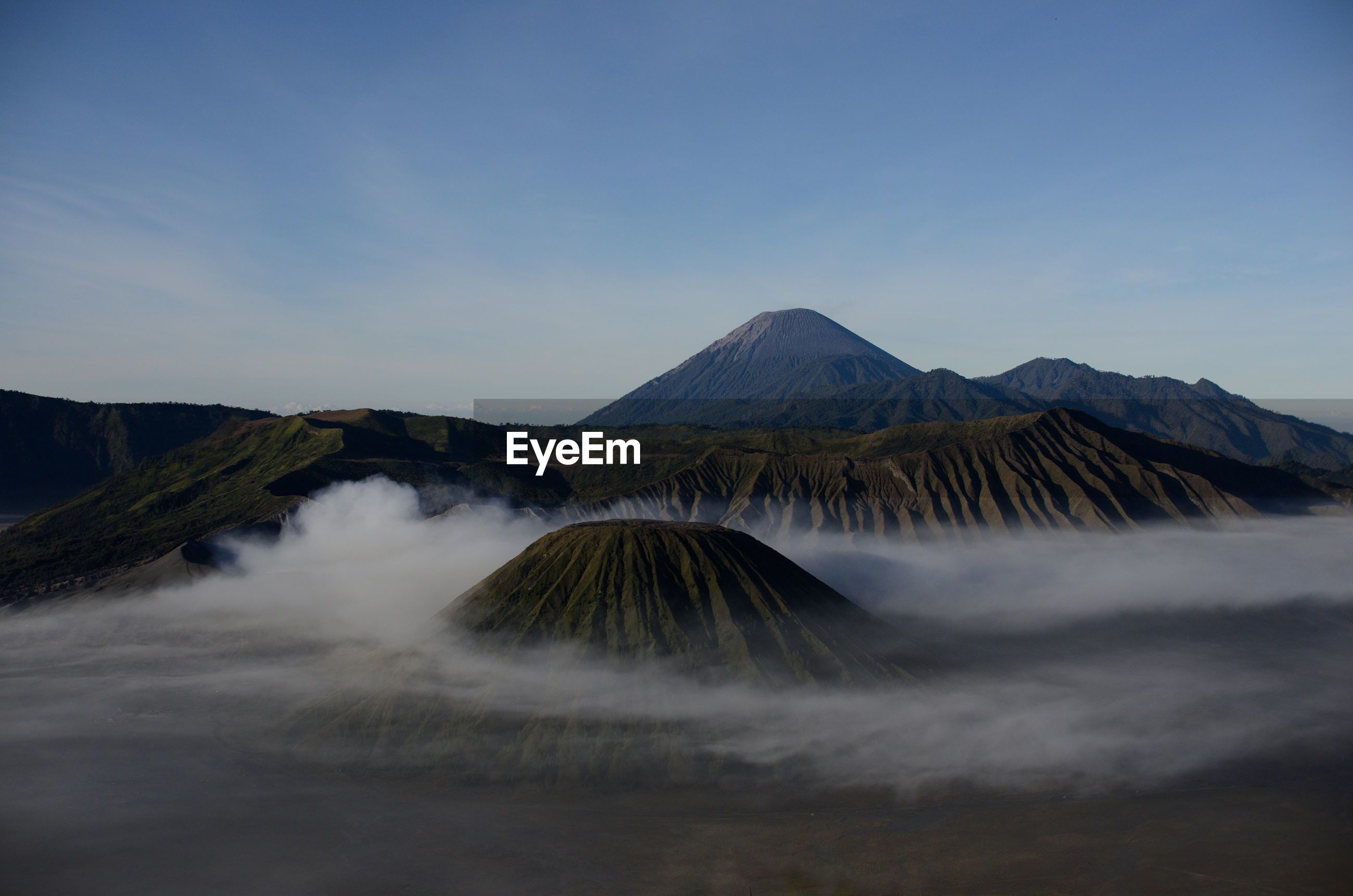 Volcanic mountains against sky