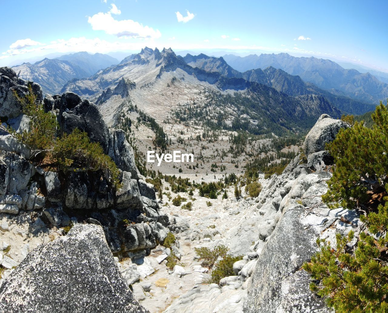 mountain, scenics - nature, beauty in nature, sky, mountain range, tranquil scene, environment, nature, landscape, rock, no people, plant, tranquility, non-urban scene, solid, day, rock - object, outdoors, cloud - sky, tree, mountain peak, formation