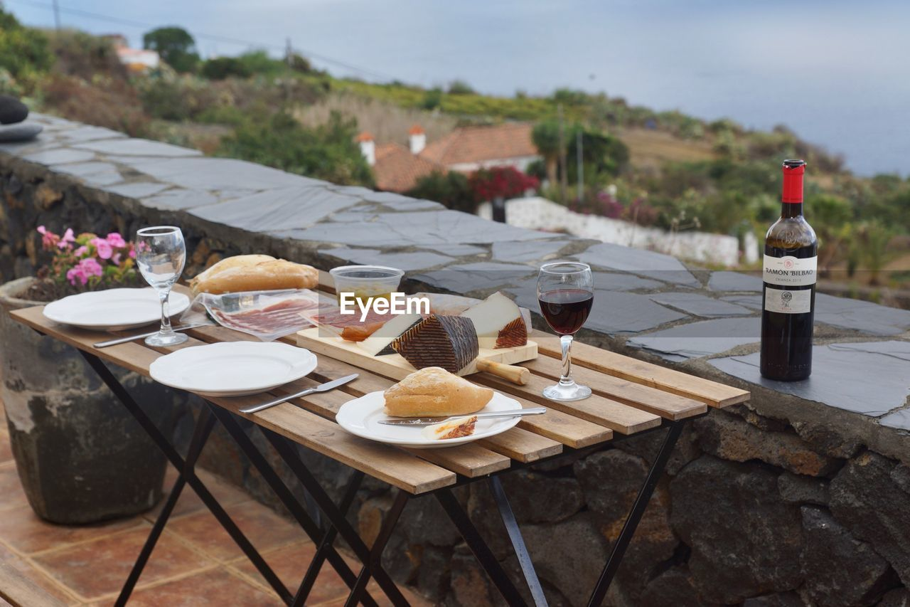 table, food and drink, wine, wineglass, outdoors, food, plate, no people, bread, drinking glass, day, drink, landscape, freshness, nature, ready-to-eat