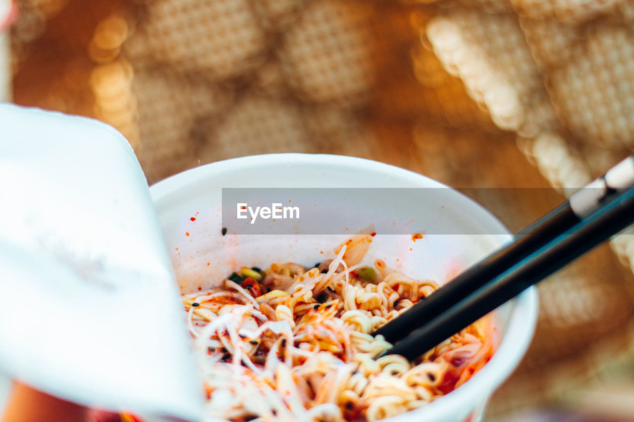 CLOSE-UP OF SOUP SERVED IN BOWL ON TABLE