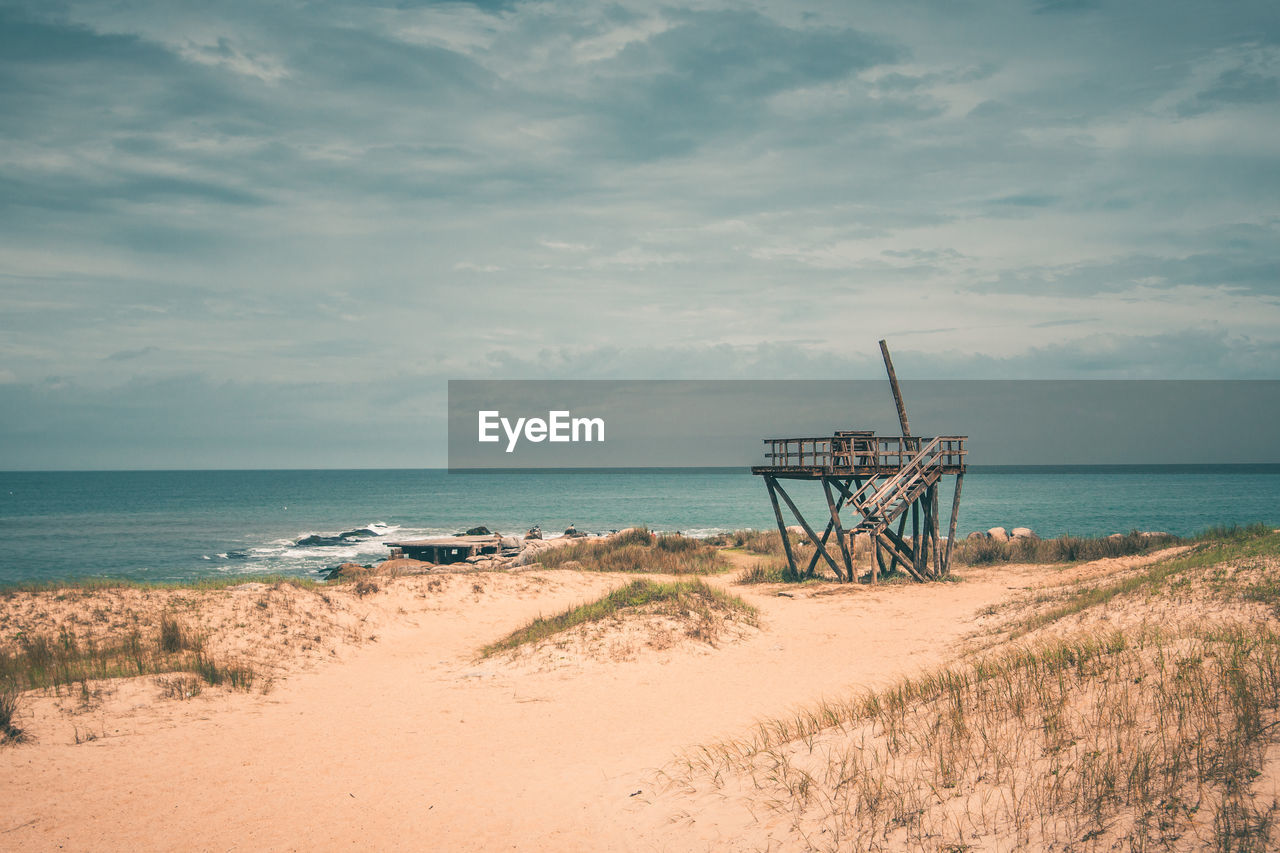 sea, sky, water, beach, land, horizon, horizon over water, scenics - nature, tranquil scene, cloud - sky, beauty in nature, nature, tranquility, sand, no people, non-urban scene, day, architecture, outdoors