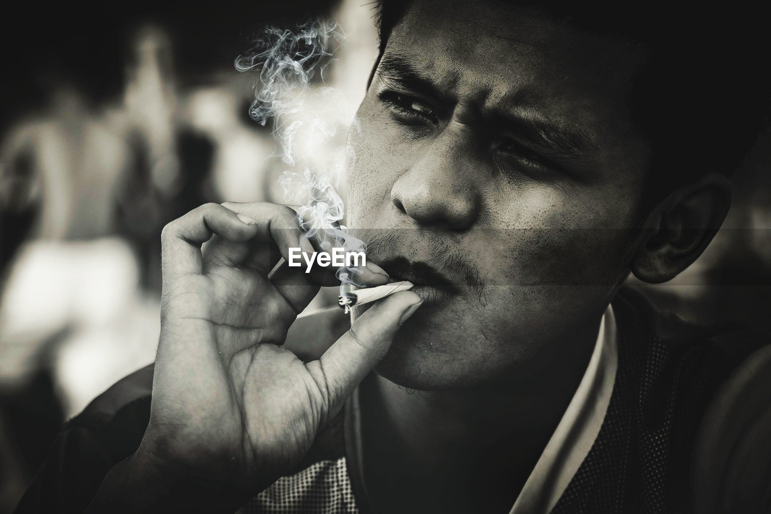 smoking issues, social issues, bad habit, cigarette, smoking - activity, warning sign, smoke - physical structure, real people, risk, sign, activity, one person, holding, headshot, portrait, tobacco product, communication, men, mature men, human face