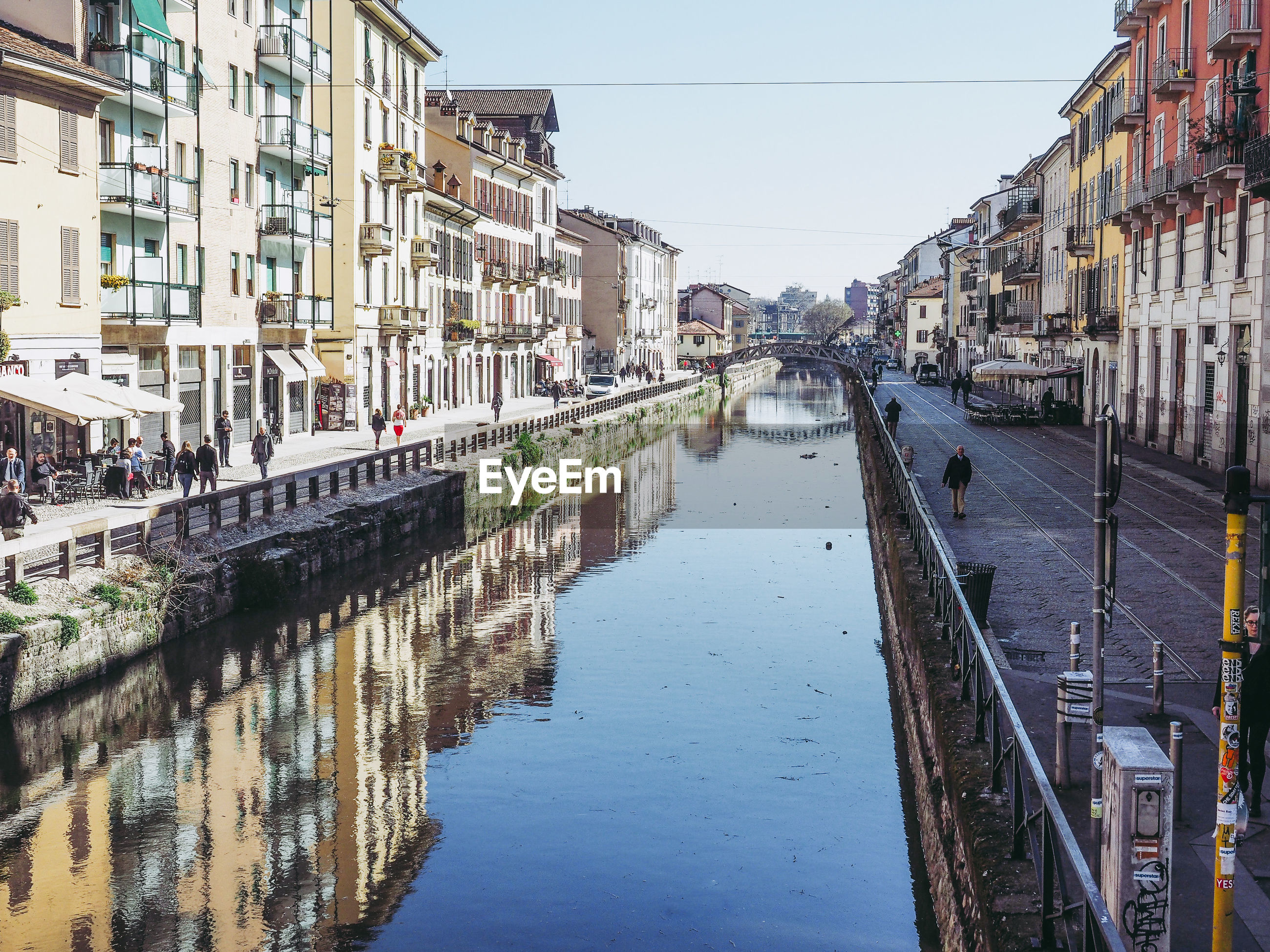 PANORAMIC VIEW OF CANAL AMIDST BUILDINGS IN CITY