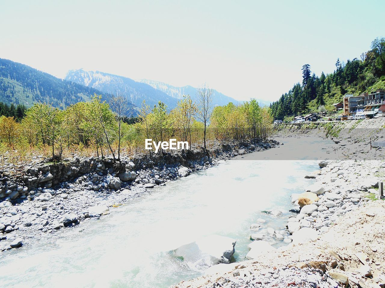 mountain, nature, tree, river, scenics, beauty in nature, rock - object, outdoors, tranquil scene, day, no people, tranquility, water, landscape, clear sky, sky