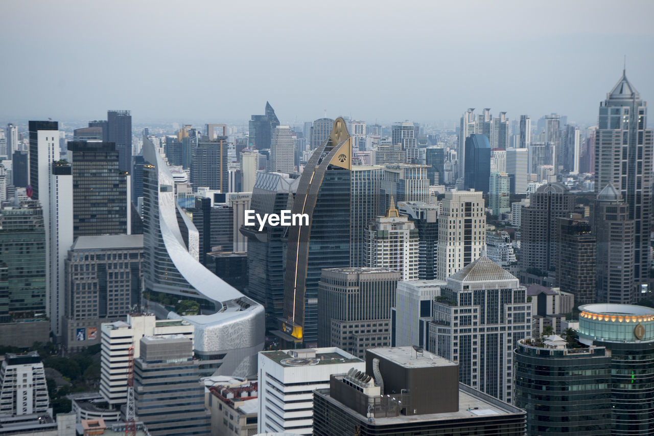 building exterior, built structure, building, architecture, cityscape, city, office building exterior, skyscraper, sky, tall - high, no people, modern, nature, residential district, tower, landscape, office, high angle view, urban skyline, financial district, outdoors, settlement, spire