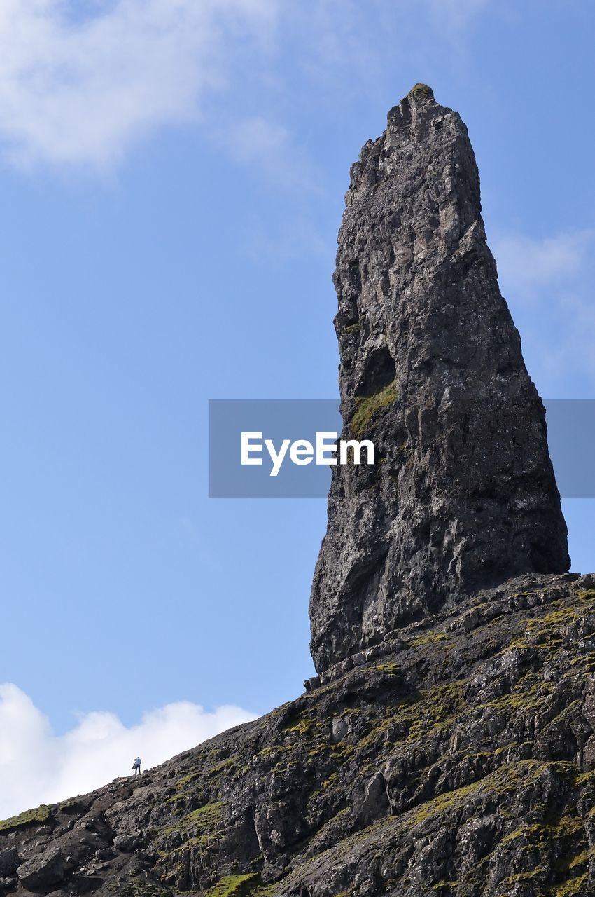 Low Angle View Of Rock On Mountain Against Sky