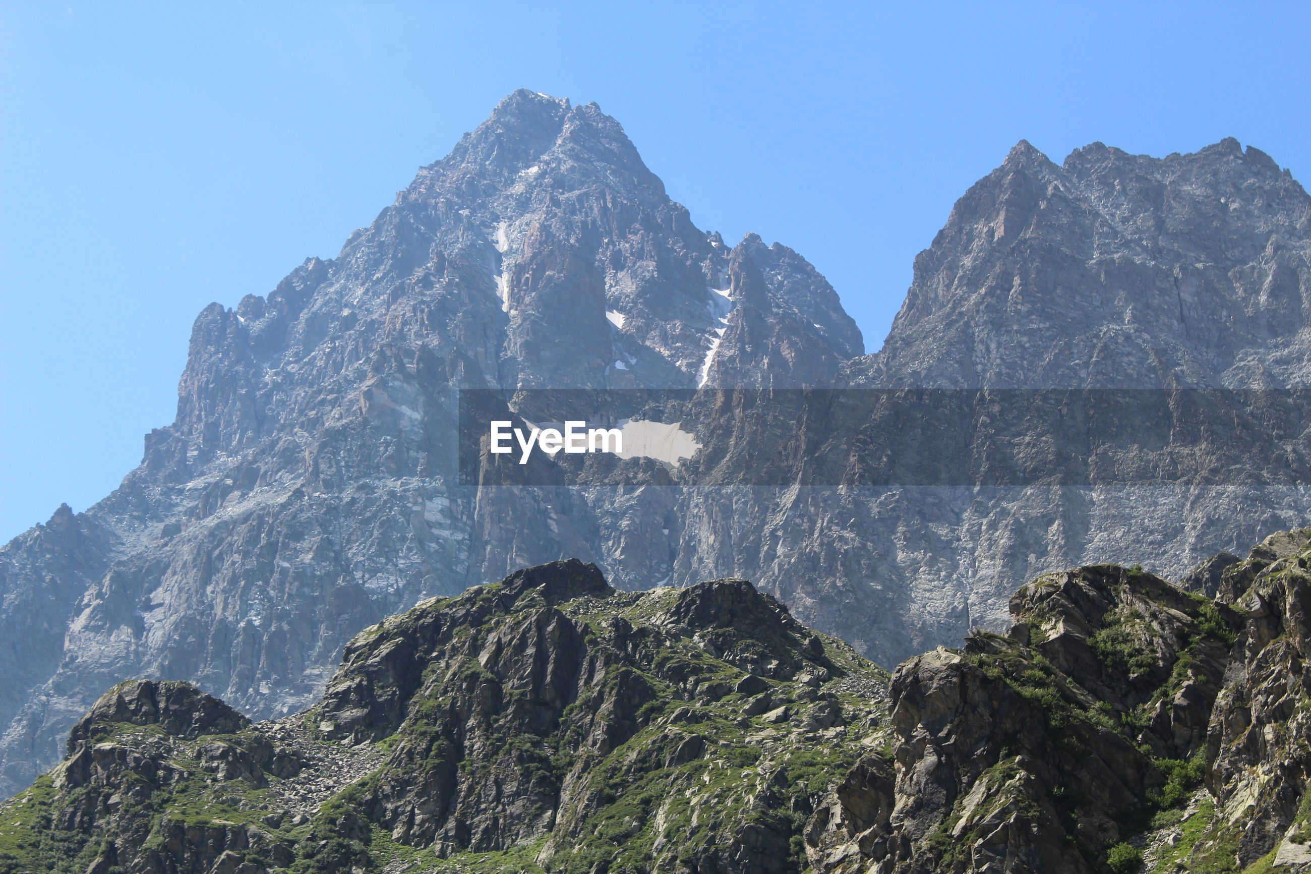 Panoramic view of rocks and mountains against clear sky