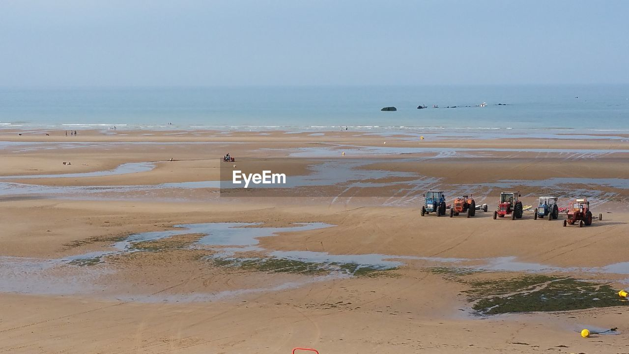 Tractors On Sand At Beach