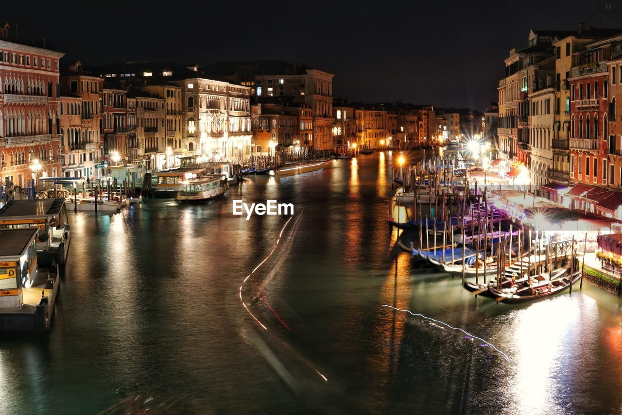 building exterior, illuminated, water, architecture, transportation, night, nautical vessel, city, built structure, mode of transportation, reflection, waterfront, building, canal, moored, no people, nature, residential district, sailboat, nightlife