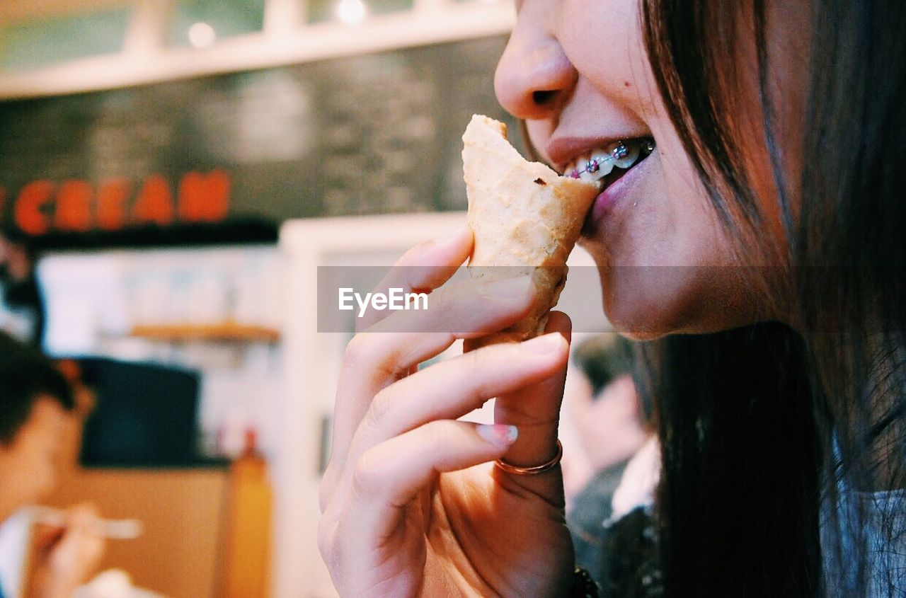 Close-Up Of Woman Eating Ice Cream