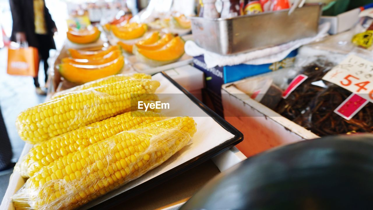 food and drink, still life, food, freshness, corn, table, indoors, selective focus, close-up, no people, yellow, sweetcorn, wellbeing, healthy eating, for sale, ready-to-eat, market, choice, high angle view, corn on the cob, retail display