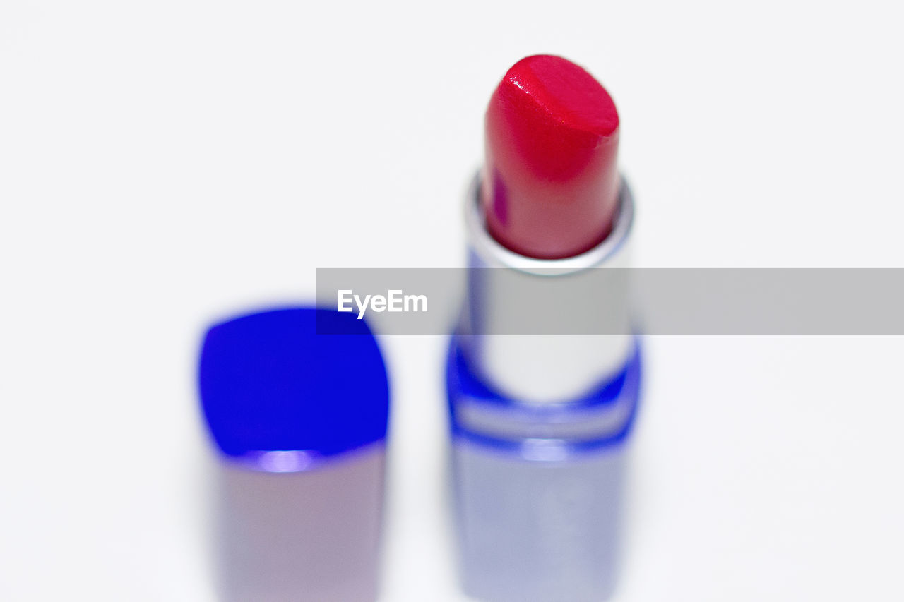 Close-up of red lipstick against white background