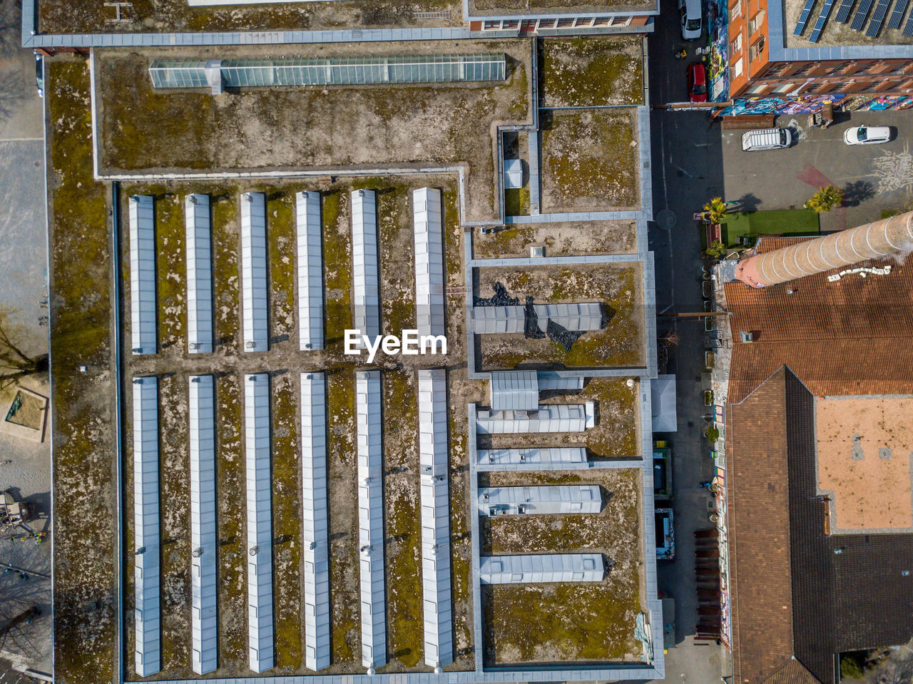 architecture, no people, built structure, building exterior, day, building, outdoors, high angle view, industry, barrier, development, boundary, fence, nature, metal, city, pattern, residential district, construction industry, entrance