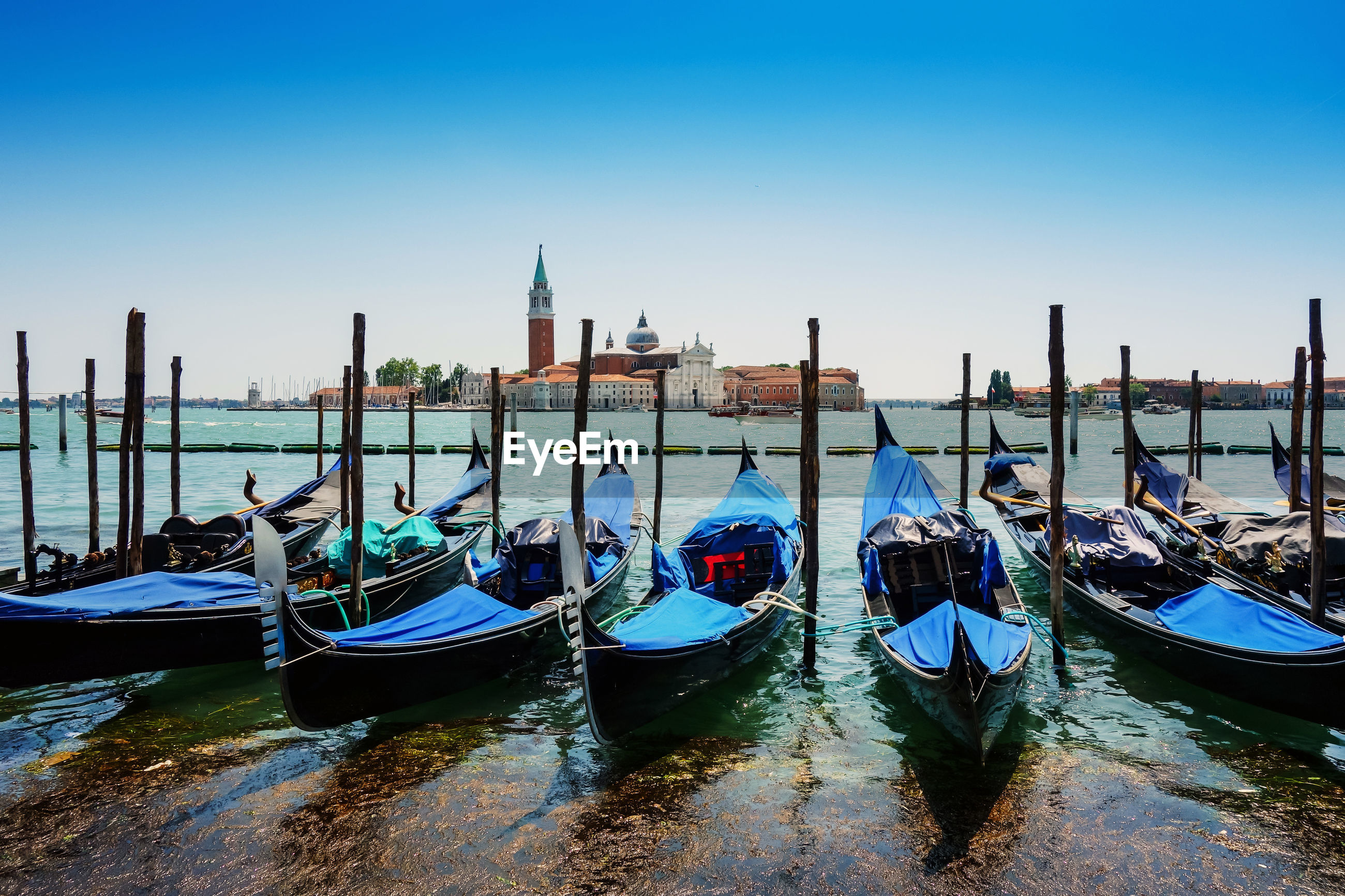 Gondolas moored at grand canal in city