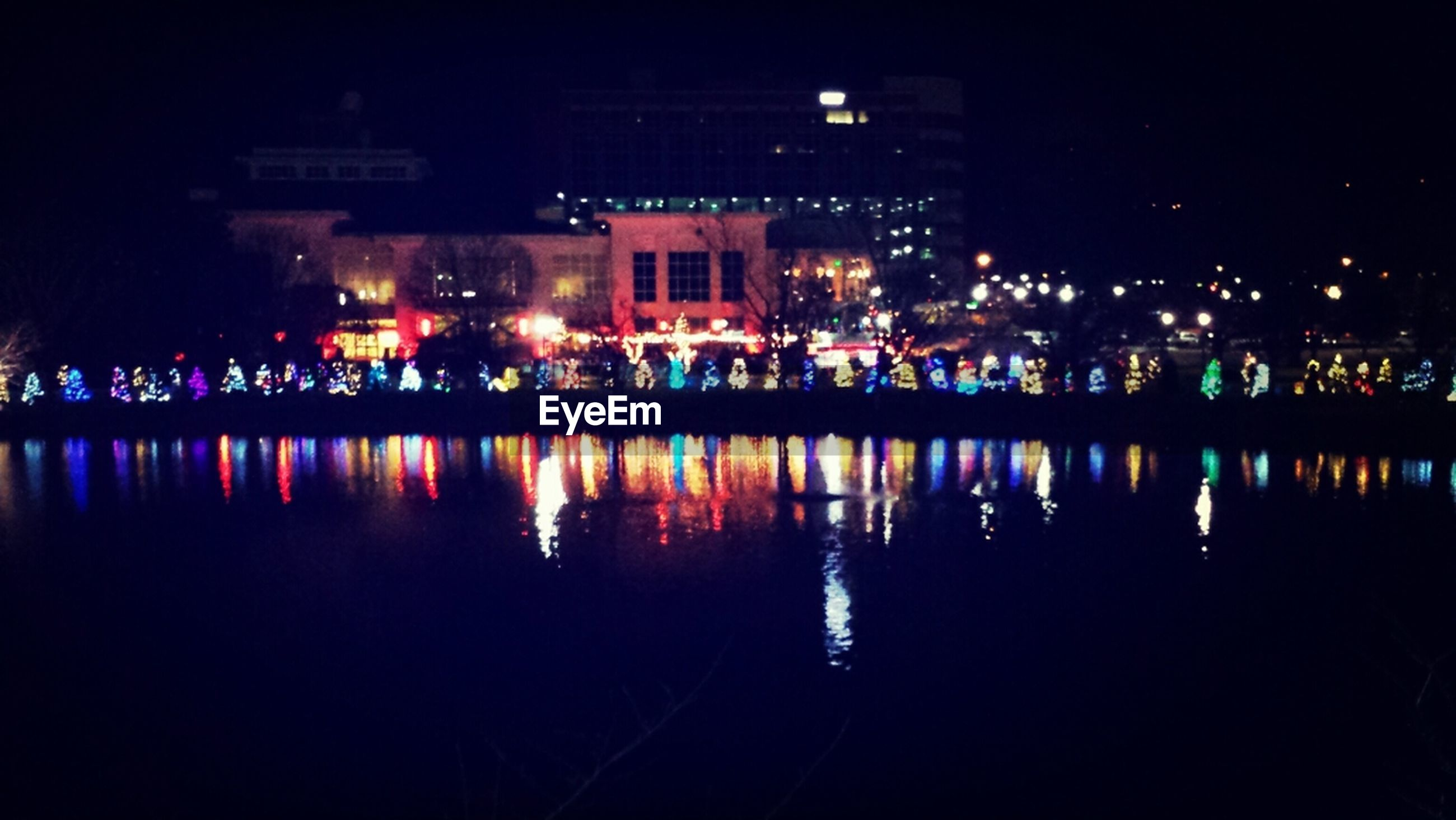 illuminated, water, reflection, night, building exterior, architecture, built structure, waterfront, city, river, lake, outdoors, no people, sky, residential building, house, residential structure, building, canal, city life