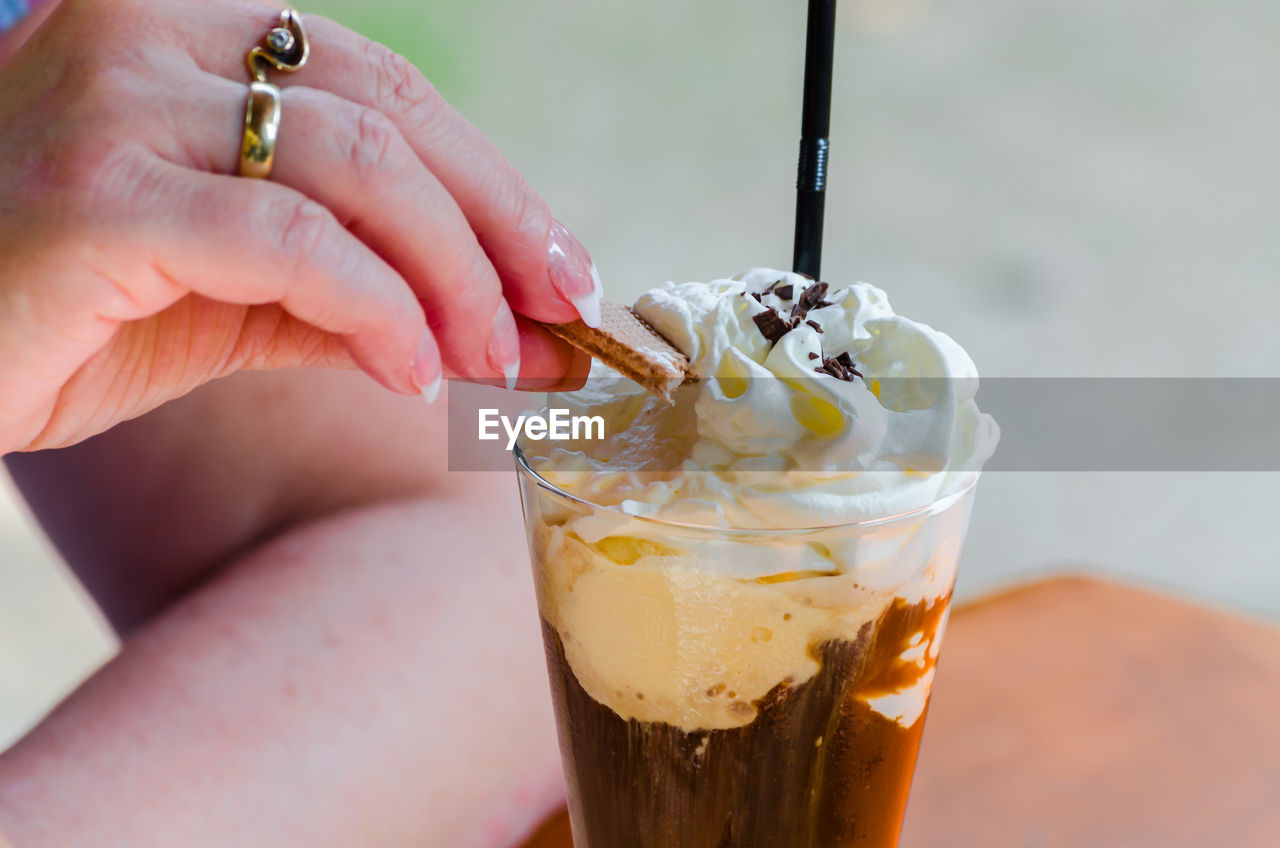 Close-Up Of Female Hand With Iced Coffee