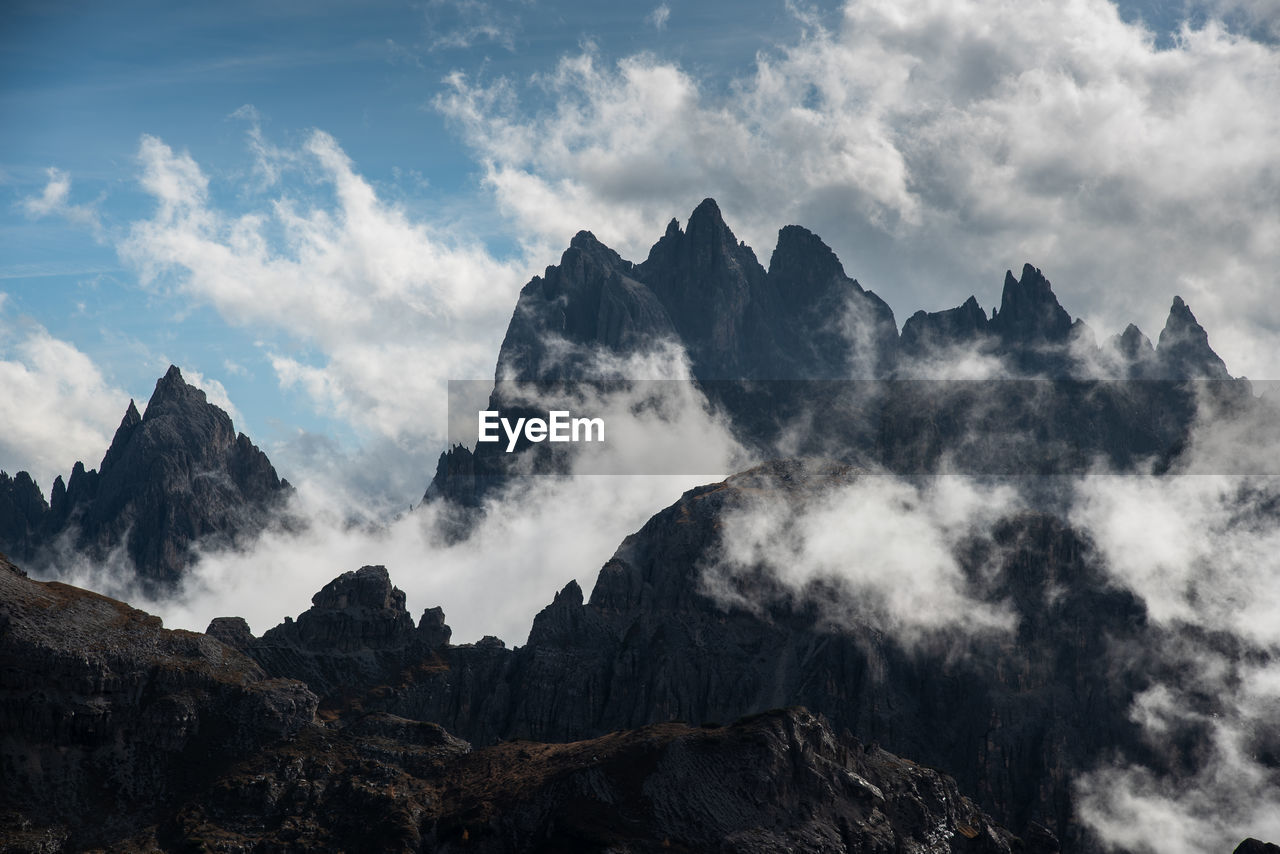 Mountain peaks covered with clouds at tre cime di lavaredo area in italy