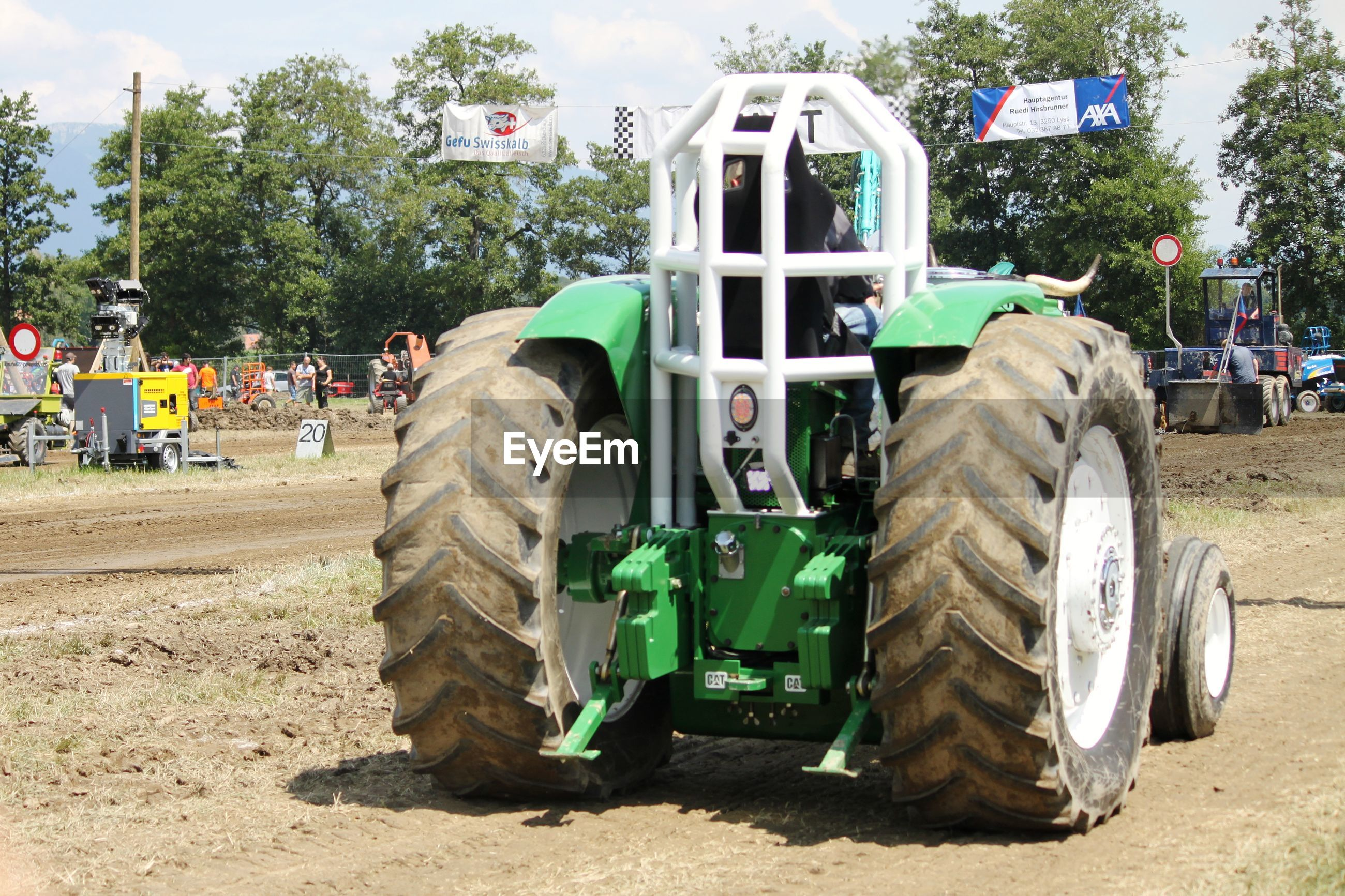 Man driving agricultural vehicle on field