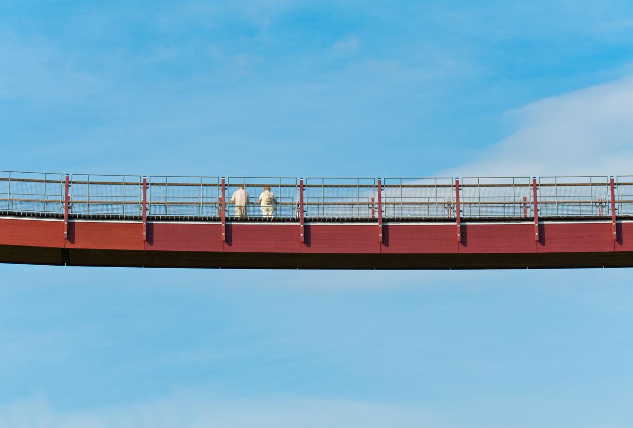 sky, low angle view, architecture, nature, blue, connection, built structure, cloud - sky, day, railing, transportation, bridge, bridge - man made structure, no people, outdoors, travel, business, rail transportation, metal