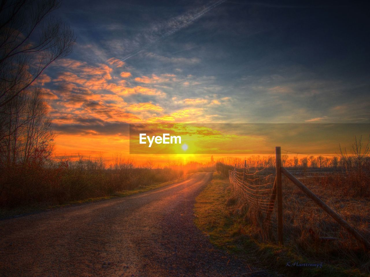 sunset, orange color, sun, tranquil scene, no people, scenics, landscape, tranquility, nature, the way forward, field, beauty in nature, sky, outdoors, rural scene, road, grass, tree, day