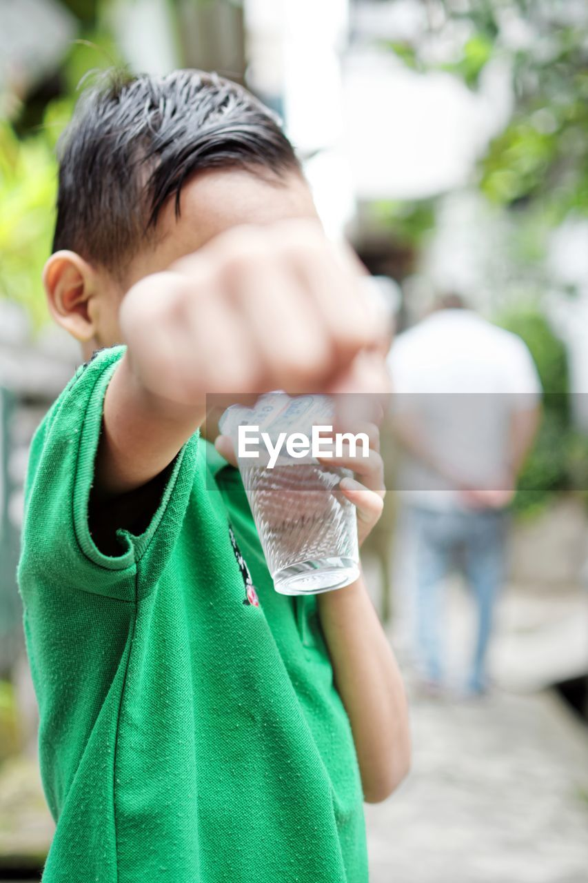 childhood, focus on foreground, boys, green color, real people, father, outdoors, holding, day, lifestyles, close-up, child, people