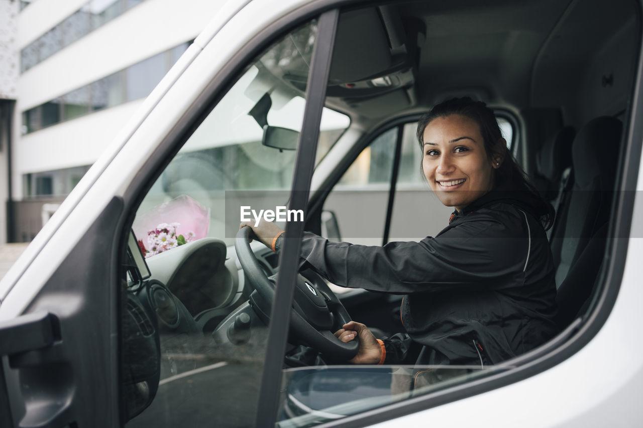 PORTRAIT OF WOMAN IN CAR