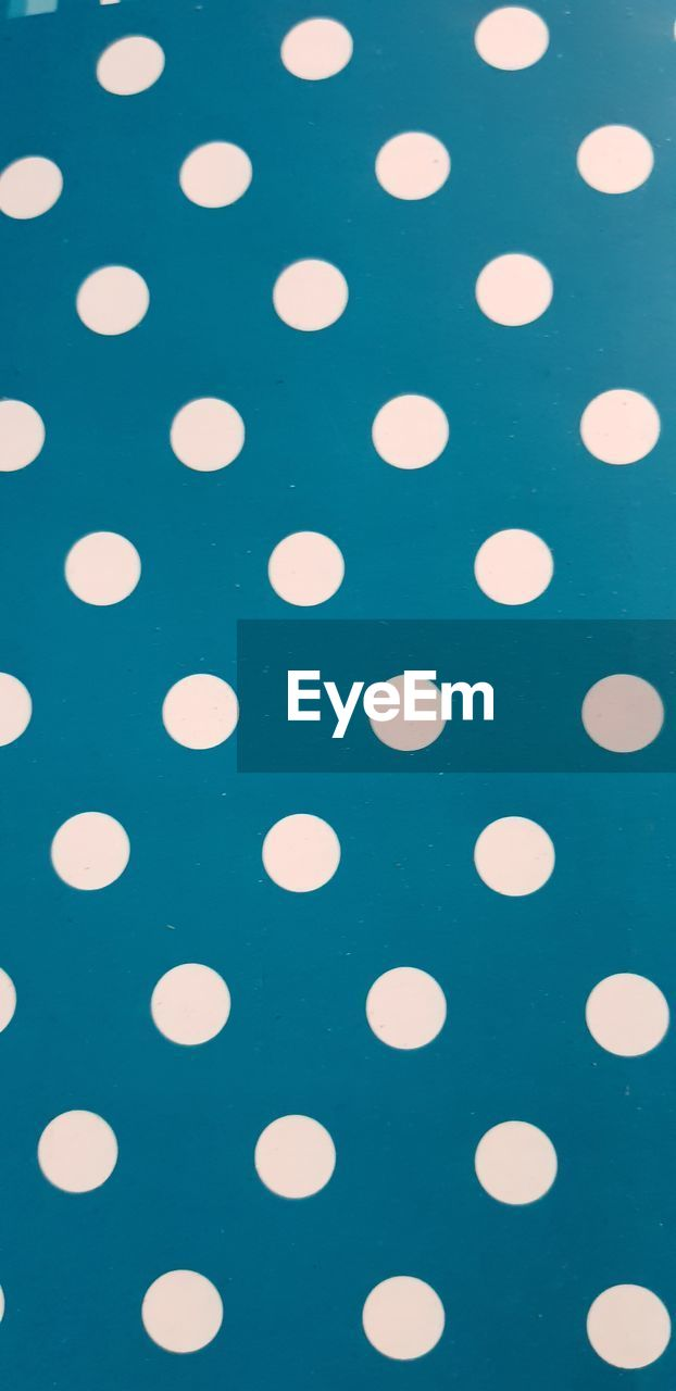 backgrounds, pattern, full frame, geometric shape, indoors, no people, circle, spotted, shape, close-up, still life, design, polka dot, high angle view, white color, repetition, blue, studio shot, textured, black color, blue background