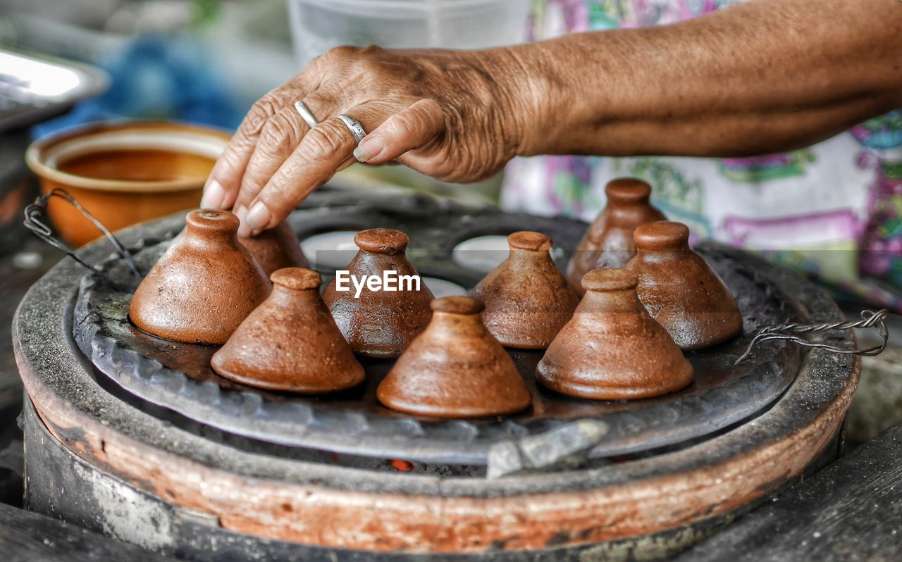 human hand, hand, human body part, one person, real people, pottery, occupation, focus on foreground, preparation, holding, working, clay, day, making, skill, finger, human finger, art and craft, men
