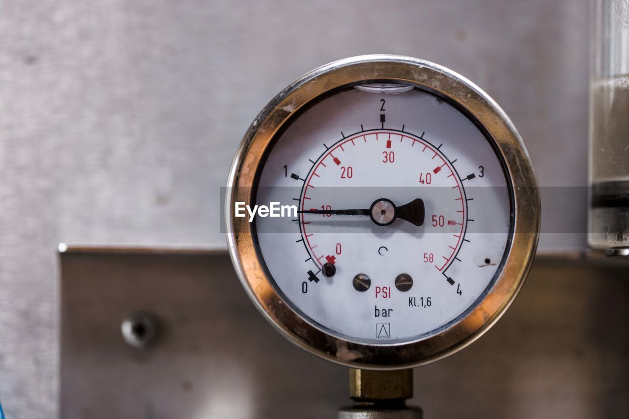 Close-up of gauge on machine