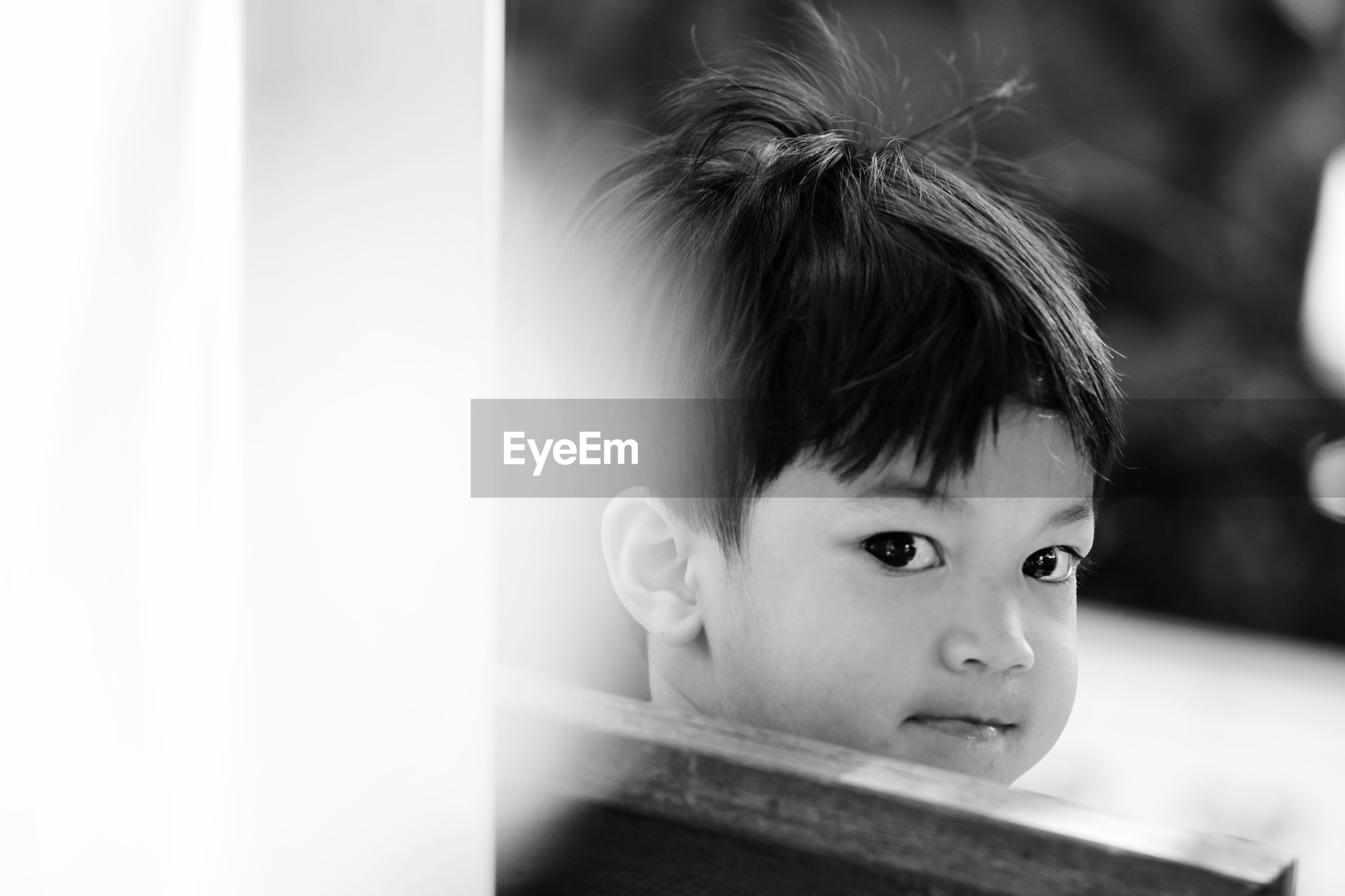 Black and white image of 3 years old asian little boy