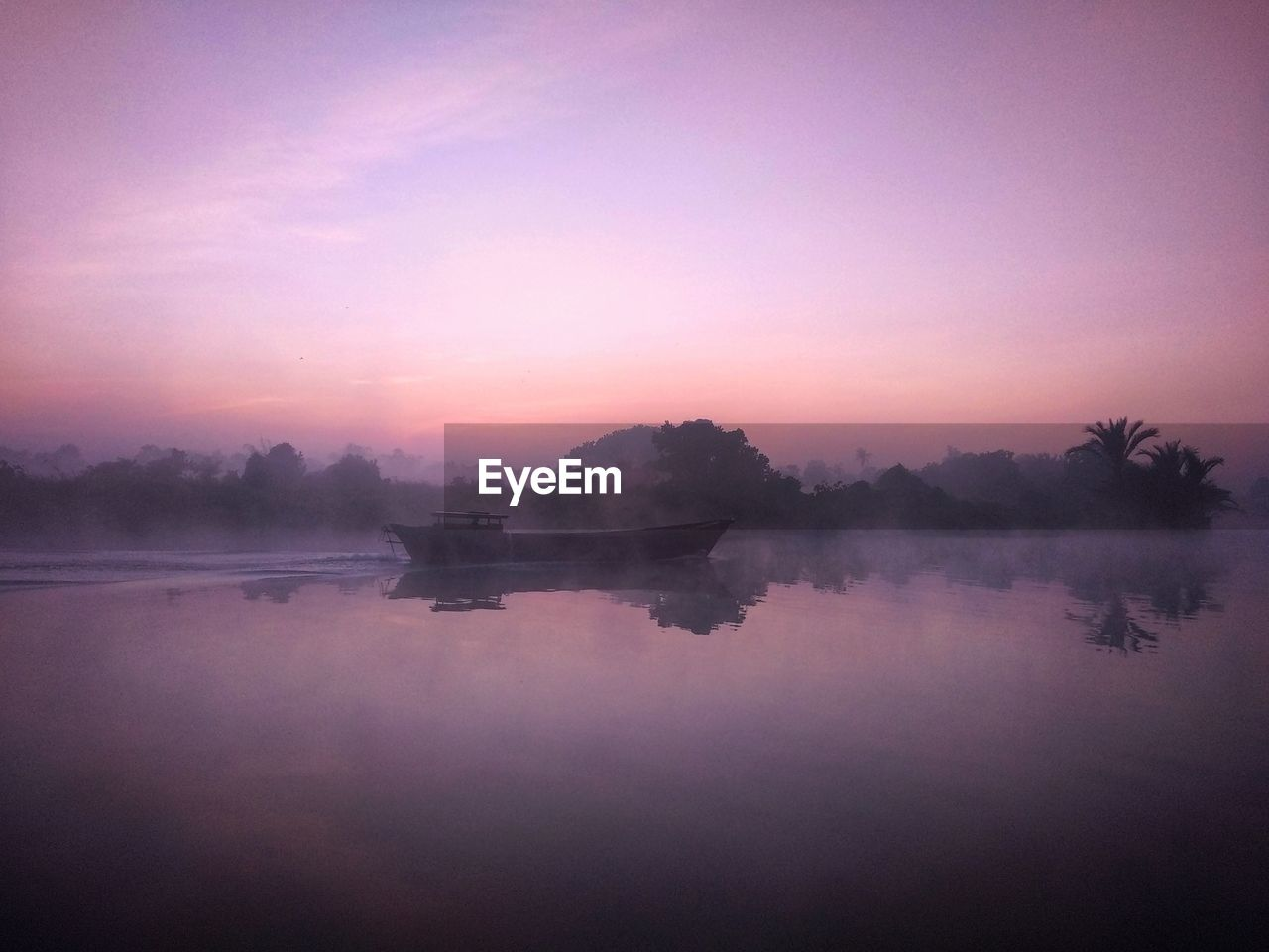 water, sky, scenics - nature, tranquility, sunset, reflection, lake, tranquil scene, beauty in nature, fog, nature, idyllic, no people, waterfront, non-urban scene, nautical vessel, tree, plant, outdoors, purple