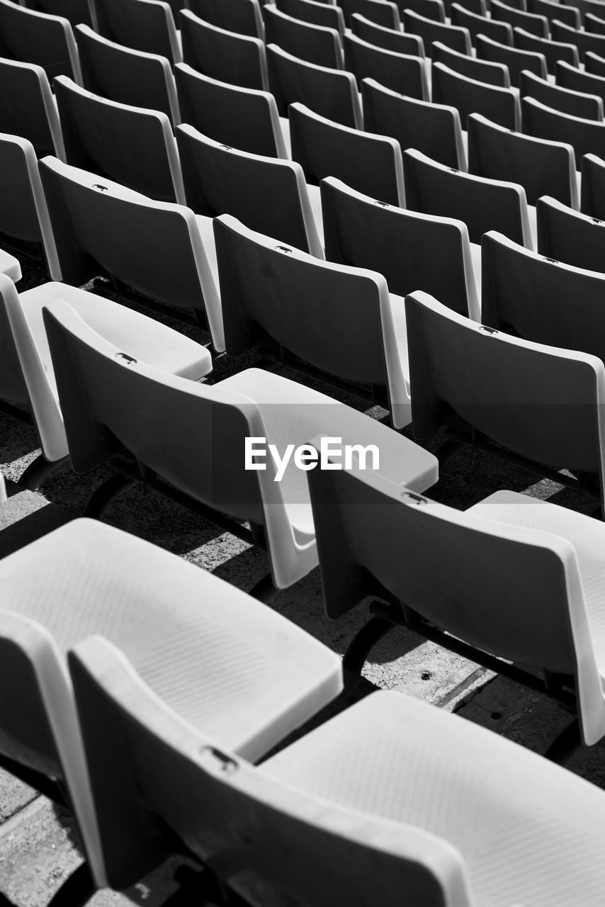 Full frame of empty chairs at stadium