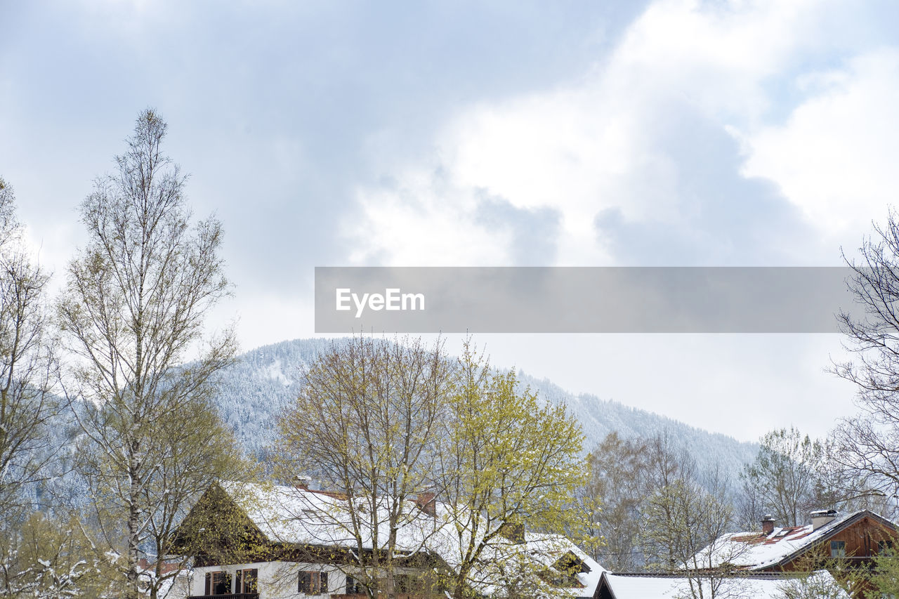 sky, cloud - sky, tree, snow, winter, plant, cold temperature, scenics - nature, beauty in nature, day, nature, mountain, architecture, building exterior, building, built structure, tranquility, tranquil scene, no people, outdoors, snowcapped mountain
