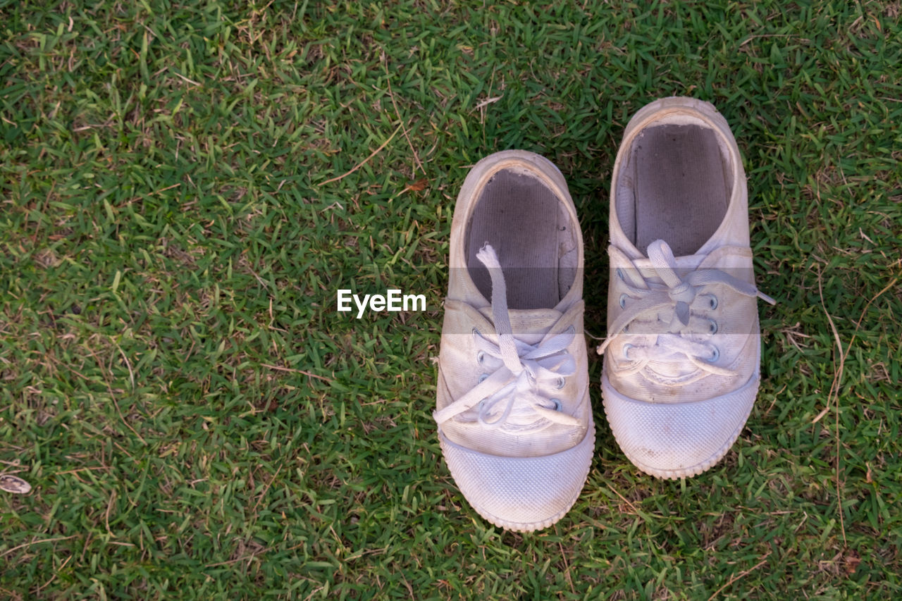 High angle view of white shoes on grass