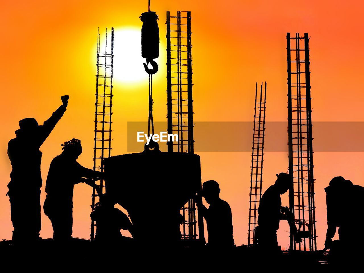 Silhouette Construction Workers Working Against Sky During Sunset