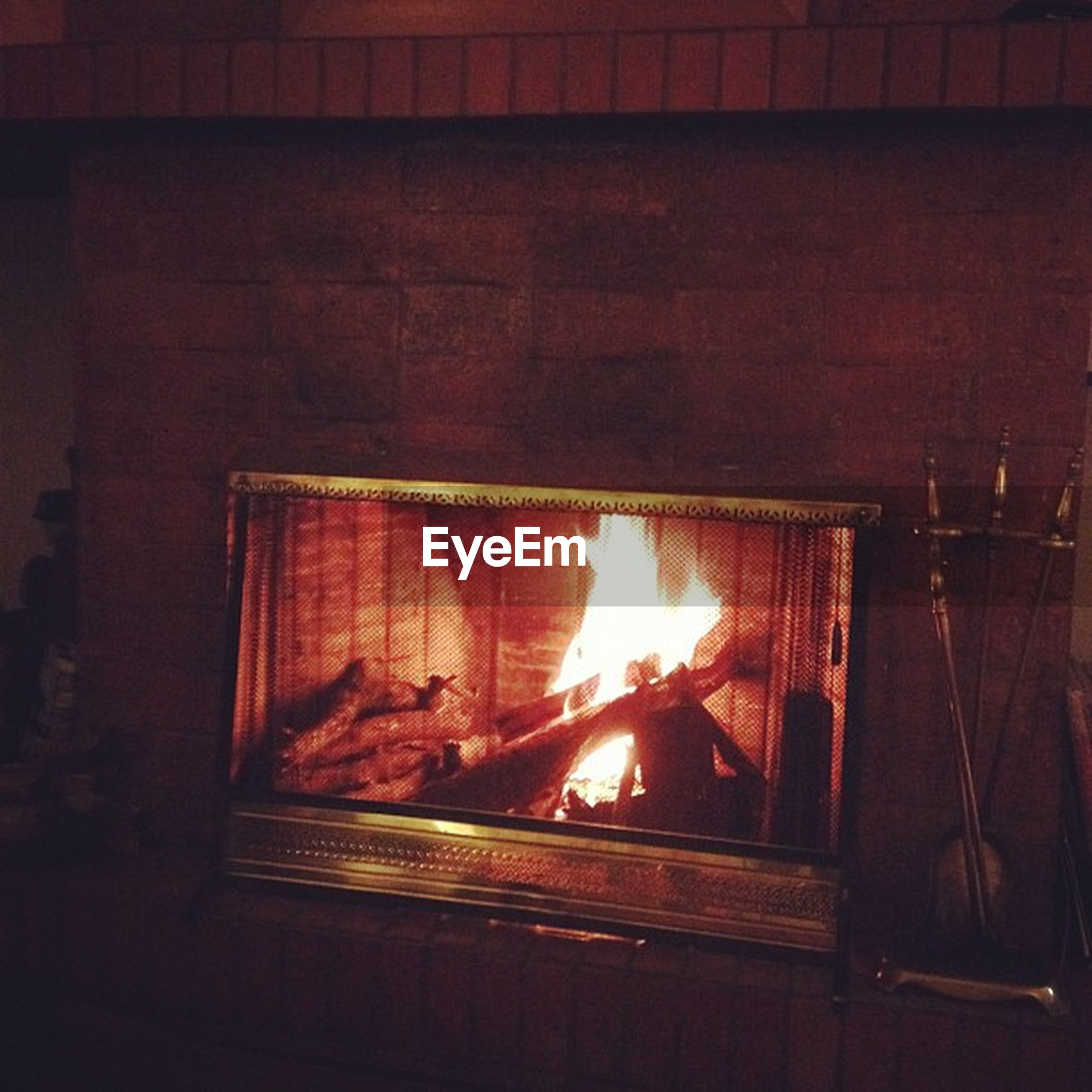 flame, burning, heat - temperature, fire - natural phenomenon, glowing, orange color, wood - material, illuminated, indoors, fire, built structure, no people, close-up, house, night, wall - building feature, light - natural phenomenon, dark, sunlight, architecture