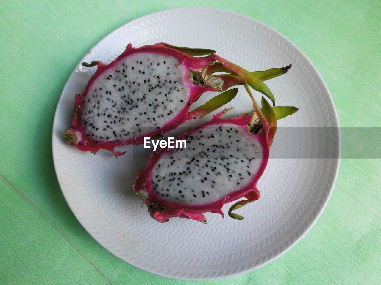 High Angle View Of Sliced Dragon Fruit On Plate