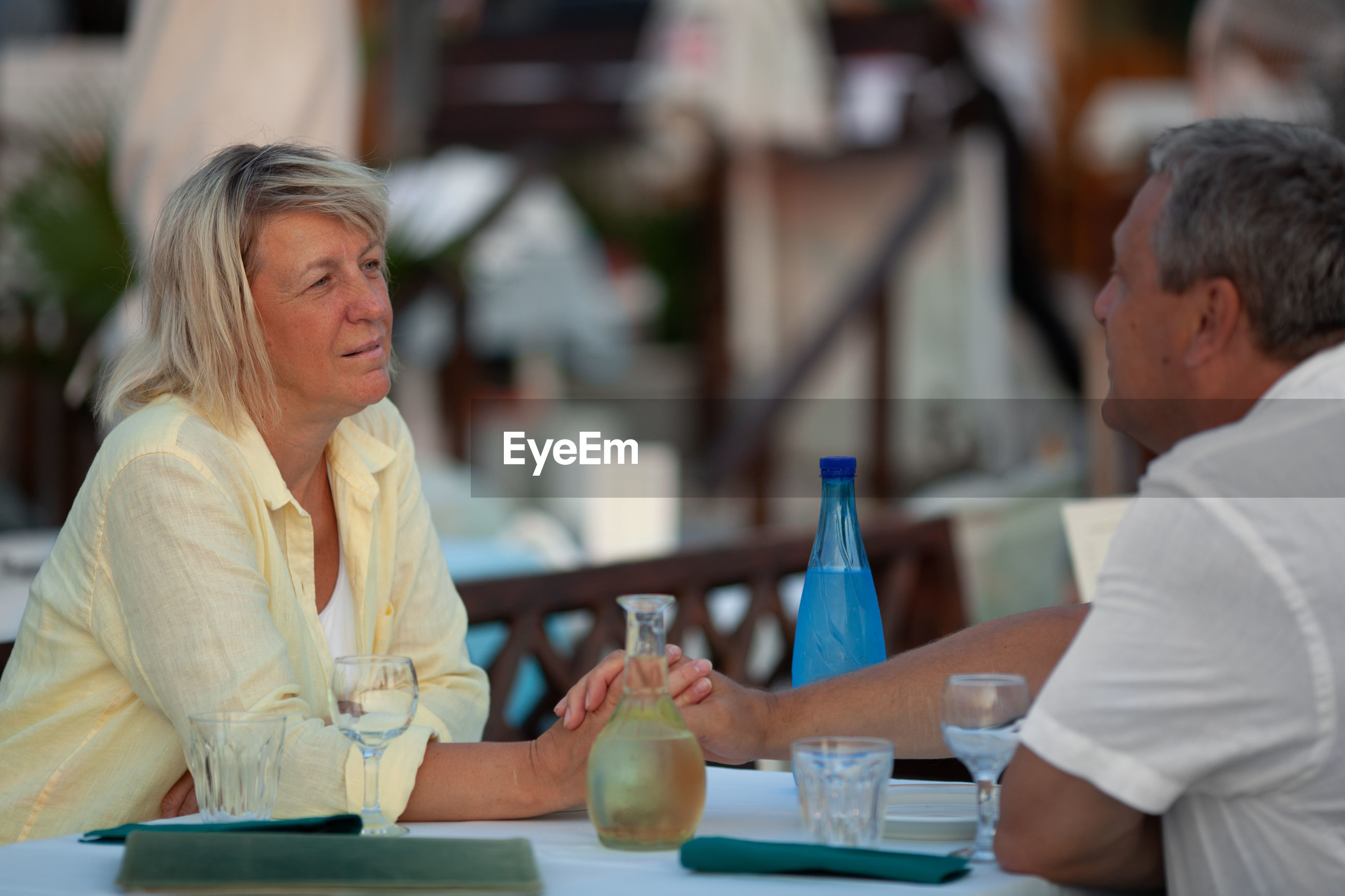 Mature couple sitting at restaurant table