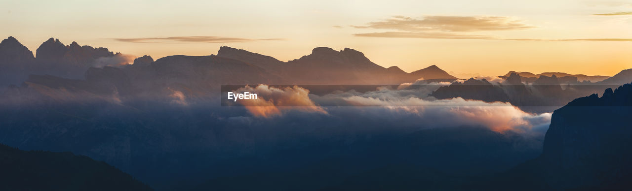 Panoramic View Of Silhouette Mountains Against Sky During Sunset