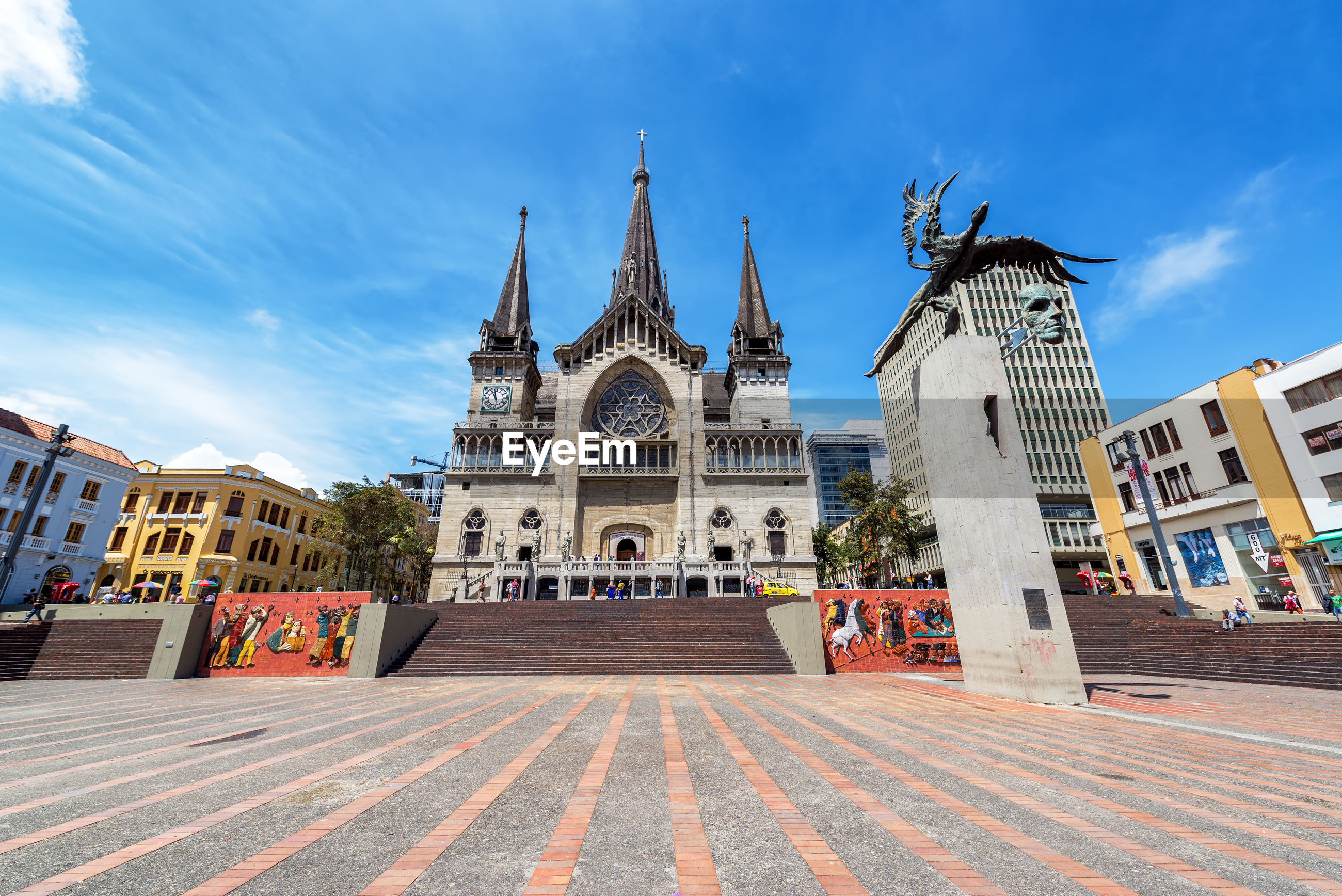 Monument and manizales cathedral at bolivar plaza