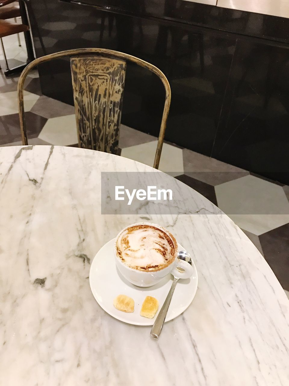 coffee cup, coffee - drink, drink, food and drink, table, refreshment, cafe, cup, saucer, chair, cappuccino, frothy drink, high angle view, latte, indoors, no people, freshness, serving size, froth art, plate, food, healthy eating, ready-to-eat, day, close-up, mocha