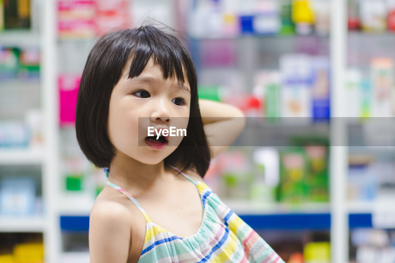 childhood, child, portrait, one person, real people, cute, focus on foreground, innocence, indoors, headshot, front view, looking, casual clothing, women, standing, bangs, hairstyle