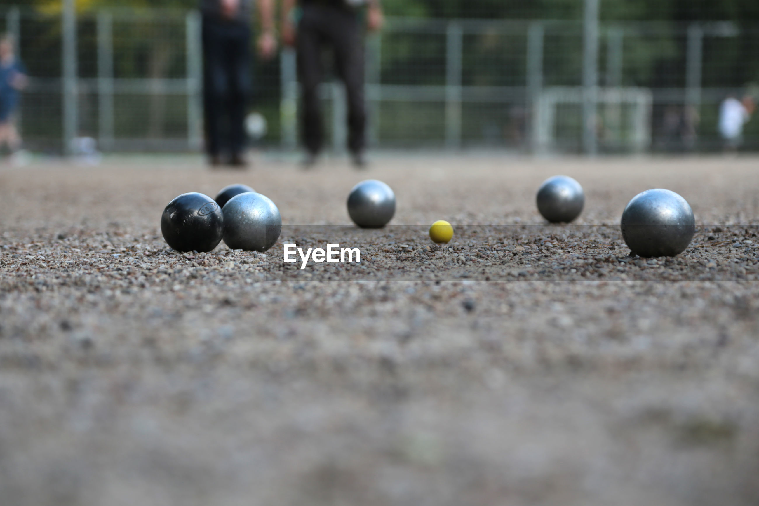 2006 - petanque ball boules and small yellow jack on petanque field,