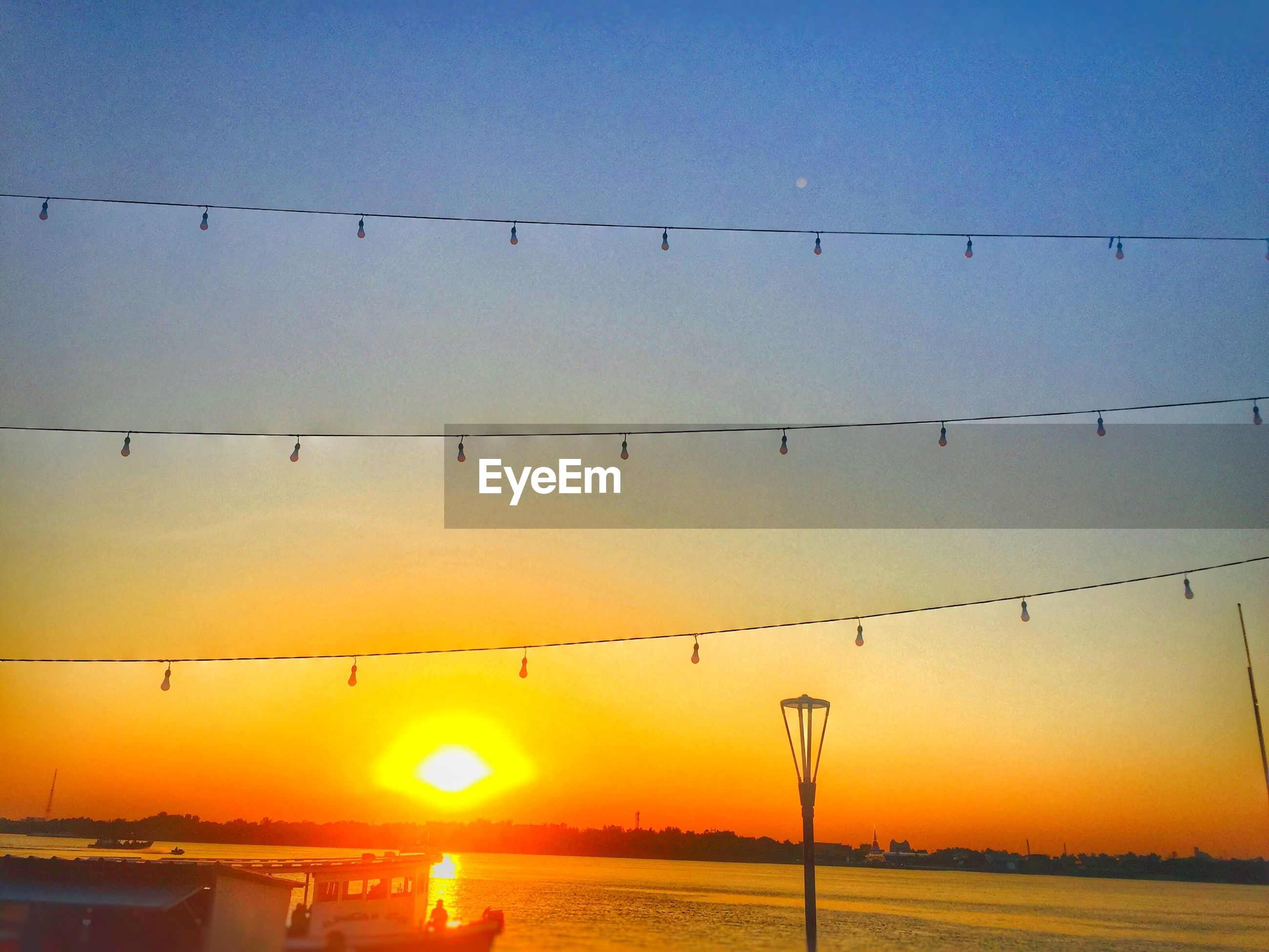 SCENIC VIEW OF SUNSET AGAINST CLEAR SKY DURING ORANGE